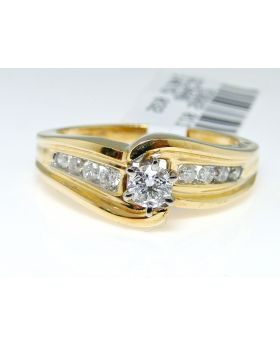 Round Cut Solitaire & Channel Set Diamond Ring in 14K Yellow Gold